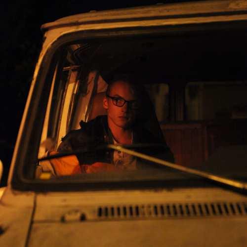 Kai sleeping in the van